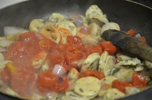 Cooking sausages for pasta primavera