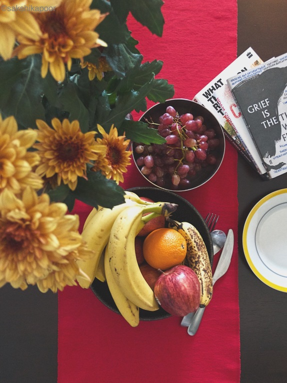 Flat lay with fruits and flowers