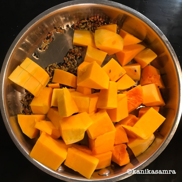 Cooking squash with tadka.